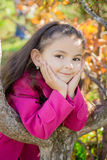 Girl near a tree in the park Royalty Free Stock Photography