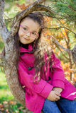 Girl near a tree in the park Stock Image