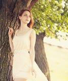 Girl near tree Stock Image
