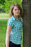 Girl near the tree Royalty Free Stock Photo
