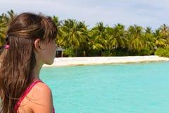 Girl near tropical beach Stock Photos