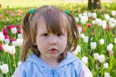 Girl near tulips Royalty Free Stock Photos