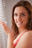 Girl near venetian blinds in the morning Stock Photo