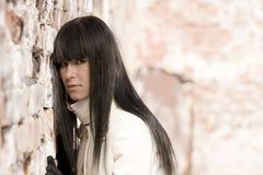 Girl near wall Stock Photography