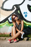 Girl near wall with graffiti Stock Photo