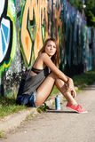 Girl near wall with graffiti Stock Image