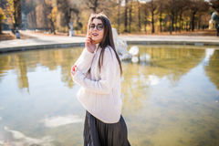 Girl near water over fountain background Stock Photography
