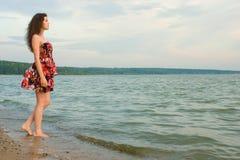 Girl near water on sea coast. Beautiful girl near water on sea coast Stock Image