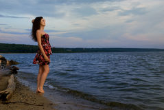 Girl near water on sea coast Royalty Free Stock Photo