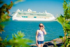 Girl near water and ship Stock Photo