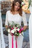 Girl near the wedding arch Stock Image