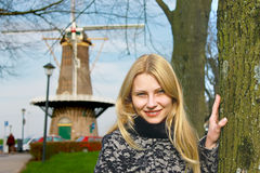 Girl near windmill in Dutch town of Gorinchem. stock images