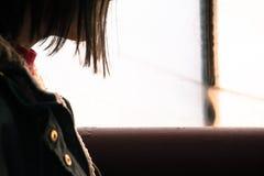 Girl near window Stock Image