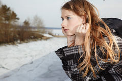 Girl near winter river Royalty Free Stock Photos