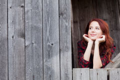 Girl near a wooden wall. Royalty Free Stock Photo