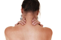 Girl with neck pain. Royalty Free Stock Image