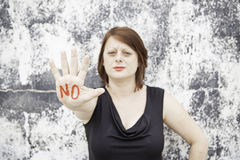 Girl with negation. No hand written in red young woman, lifestyle Stock Photo