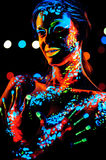 Girl with neon paint bodyart portrait Royalty Free Stock Photography