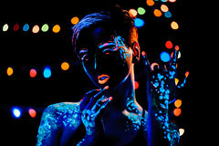 Girl with neon paint bodyart portrait Stock Photos