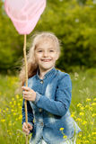 Girl with a net catching butterflies Stock Images