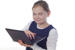 Girl with a netbook Stock Images