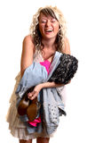 Girl with new clothes. Pleased girl and her new clothes Royalty Free Stock Photo