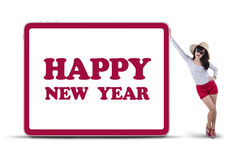 Girl with new year board Stock Images