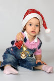 A girl is in a new-year cap. Royalty Free Stock Photo