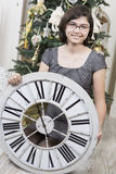 Girl with New Year clock Royalty Free Stock Image