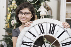 Girl with New Year clock Royalty Free Stock Photography