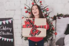 Girl new year with presents in hands Stock Photo