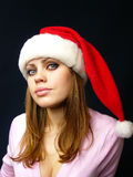 Girl in a New Year's cap Stock Image