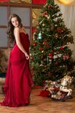Girl on new year's tree Stock Images