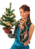 Girl with a new-year tree and tiger cub. Stock Photo