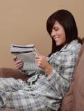 Girl and newspaper Stock Image