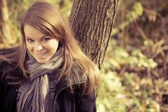 The girl next autumn trees Stock Photos