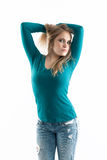 Girl next door in jeans holding hair and looking f Stock Images