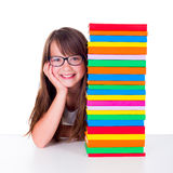 Girl next to book column Stock Images