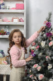 Girl near the Christmas tree Royalty Free Stock Image
