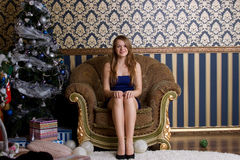 Girl next to a Christmas tree Royalty Free Stock Image