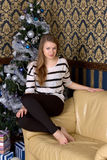 Girl next to a Christmas tree Royalty Free Stock Images