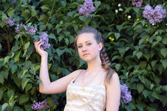 Girl next to a flowering lilac Stock Photo