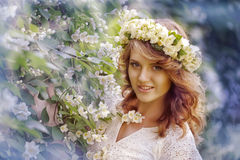 Girl next to a flowering tree Stock Image