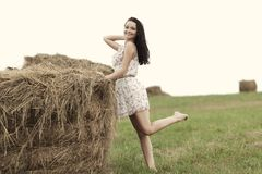 Girl next to haystack Royalty Free Stock Photo