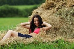 Girl next to haystack Stock Photography