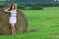 Girl next to haystack Stock Image