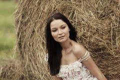Girl next to haystack Stock Photos