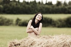 Girl next to haystack Royalty Free Stock Image