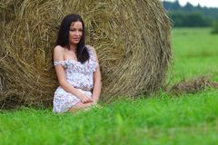 Girl next to haystack Royalty Free Stock Images