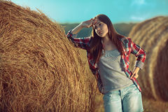 Girl next to a haystack Stock Photos
